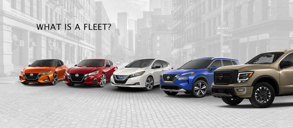 A Nissan Sentra, Nissan Altima, Nissan Leaf, Nissan Rogue and Nissan Titan XD vehicle line-up with a city background in grey scale
